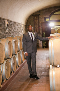 groom in Childress Vineyards barrel room