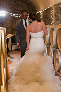 First Look with Bride and Groom in Childress Vineyards Barrel Room