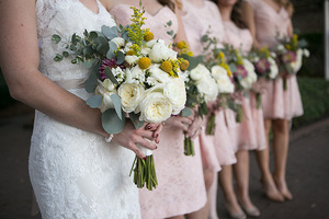bridal party at historic rice mill in charleston, sc