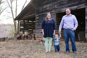 family in front of a barn