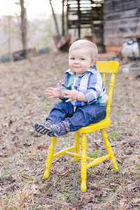baby boy and yellow chair