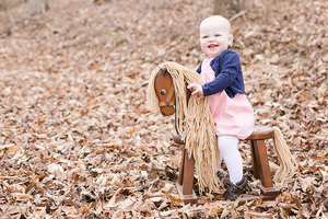 baby girl on rocking horse