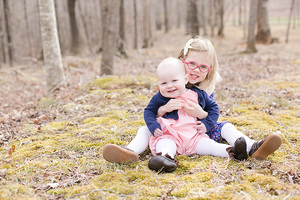 sisters sitting in moss