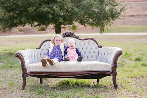 sisters sitting on victorian couch
