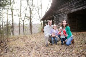 family in front of barn