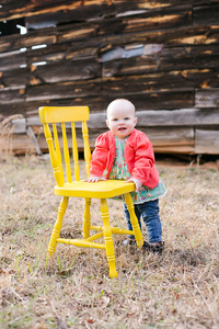 baby girl and yell chair