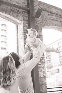 dad holding baby in the air