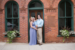 family in front of brick building