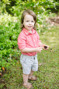 boy standing in the grass