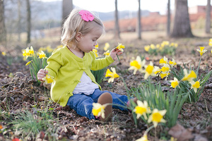 baby girl in daffodil flowers