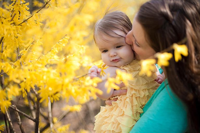 mom and baby with yellow flowers