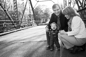 mom, dad and baby on train trusses