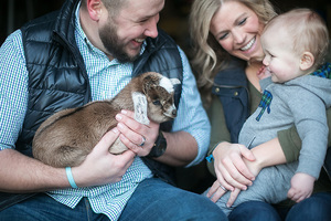 mom dad baby and baby goat