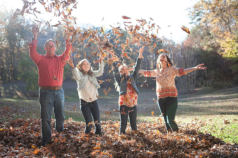family throwing leaves