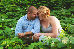 husband and wife in green leaves