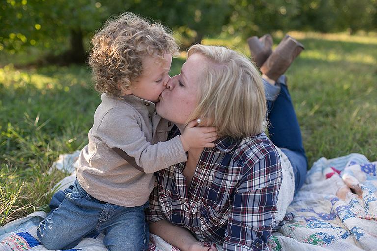 mom kissing baby boy
