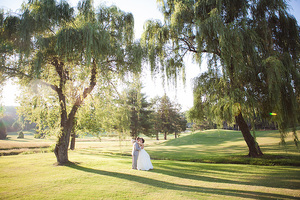 bride and groom under the weeping willows