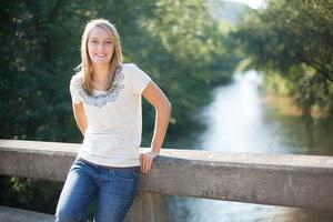 senior in front of river