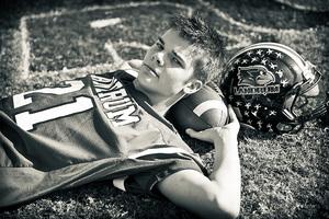 senior on football field