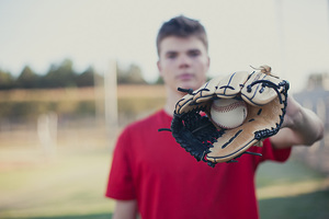 senior and baseball glove