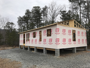 Installing Roof Trusses on NC Vacation Rental home by Carpentry Class