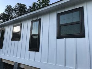 White HardieSiding and black trim and windows