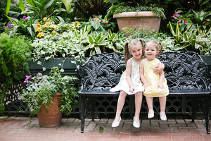 Girls on bench in Biltmore Estate Conservatory at their family photo session