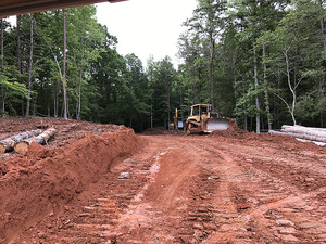 Grading land commercially for new construction at living water lane